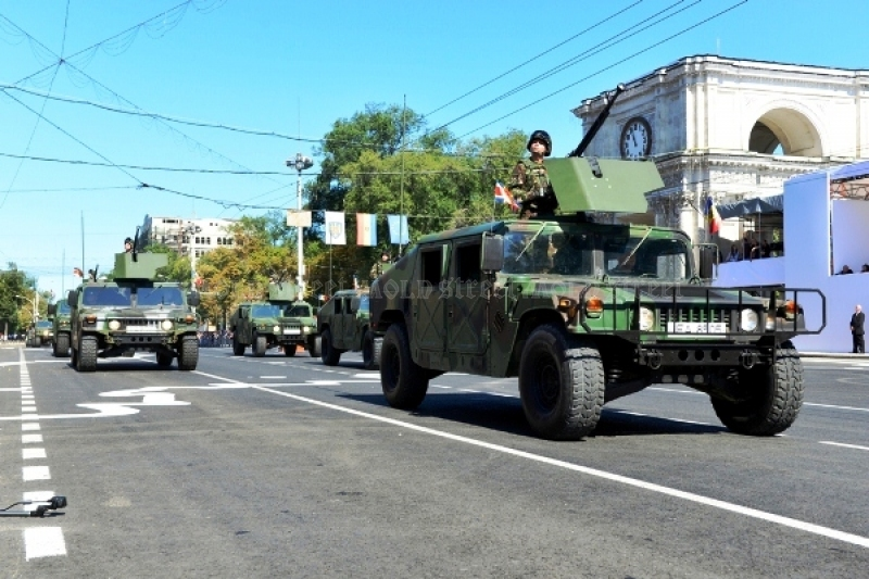 A parade with American military trucks in Chisinau